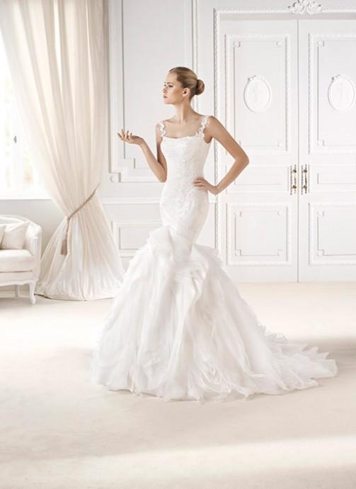 Vous rêvez d'être une princesse le jour de votre mariage ? Cette robe de mariée signée La Sposa est faite pour vous ! La coupe sirène souligne adroitement les hanches. La prochaine Kate Middleton, c'est bien vous ! Robe Eliana - La Sposa - Collection 2015
