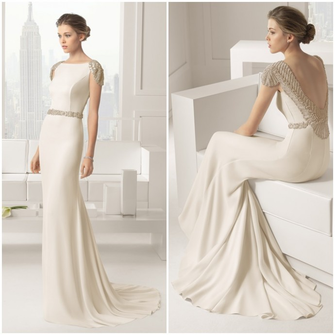 Cette robe Rosa Clara est à tomber parterre. Le décolleté perlé absolument magnifique de la robe risque de vous valoir beaucoup de compliments le jour de votre mariage.  Robe Saboya - Rosa Clara - Collection 2015