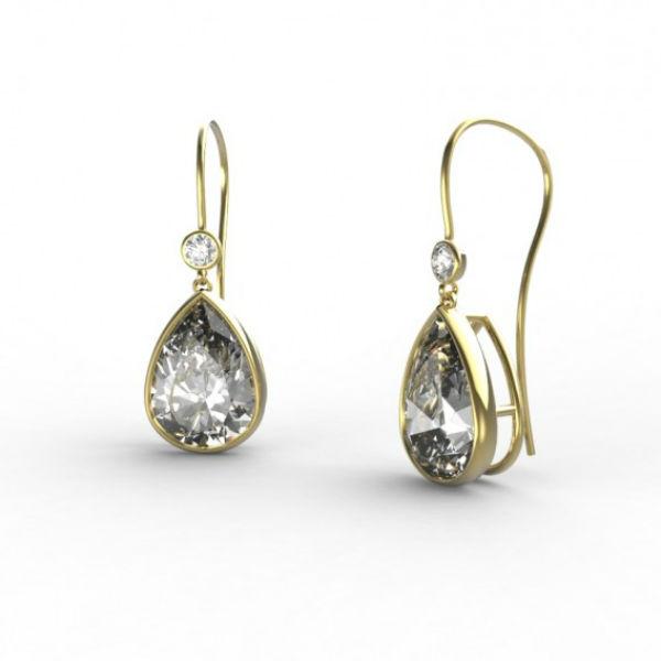 Parce que c'est votre jour J, donc votre occasion de briller, pourquoi ne pas jeter votre dévolu sur cette paire scintillante ? De taille intermédiaire, on aime sa forme de poire, très féminine. Boucles d'oreilles « Valentine », chez Gemmyo, en or jaune 18 carats et diamants, 4 355 euros.