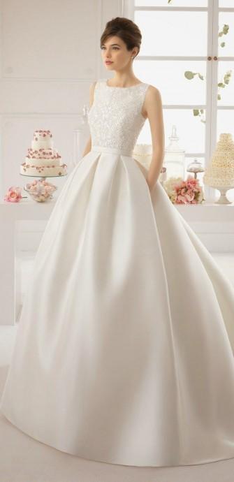 Une jupe en tafta, des poches cachées dans le pli de la robe, un buste travaillé délicatement, cette robe de princesse romantique nous a tapé dans l'oeil. Une robe signée Aire Barcelona.
