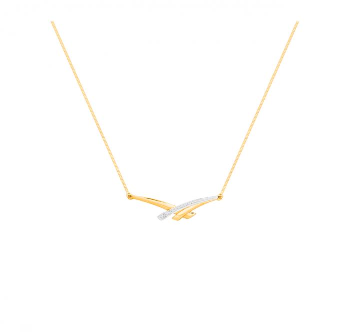 Ce collier sublimera le port de tête des mariées les plus discrètes. Collier avec diamants, bicolore en or jaune et blanc, Didier Guérin, 215 euros.