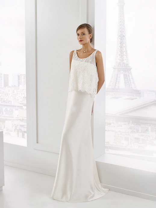 Pronuptia nous propose une composition très romantique avec cette robe droite bustier associée avec ce par-dessus de dentelle très chic. Le tout est moderne et craquant, d'ailleurs on craque ! Pronuptia, collection 2016, Esmeralda