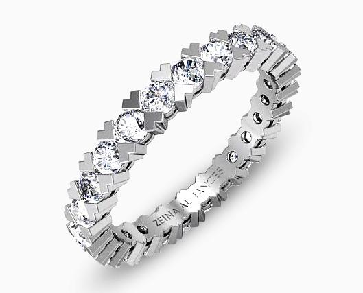 Coup de coeur pour cette alliance ultra romantique proposée par Zeina. Composée de diamants dans des griffes en forme de coeur, cette alliance est parfaite pour symboliser votre amour et votre engagement. Originale mais pas trop tape à l'oeil, elle est tout simplement parfaite.  Zeina, Anouchka, 3 654 €