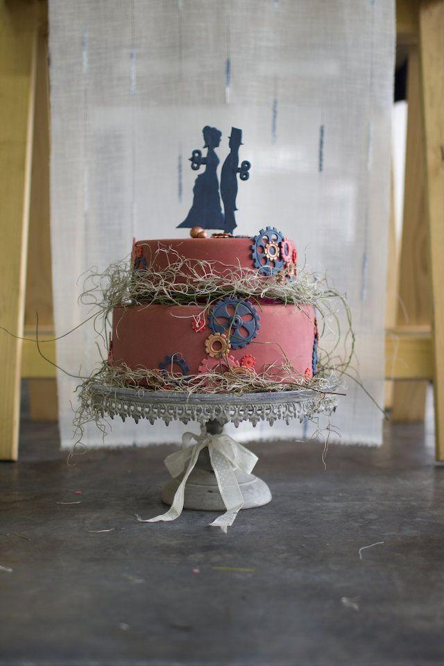 On retrouve une fois encore les engrenages, même dans le couple au-dessus du gâteau, symbole de la Révolution Industrielle.