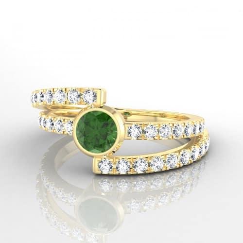 """On dit """"Oui"""" à cette alliance aux courbes sensuelles et à l'allure rétro. Ici, les deux joncs en or jaune sertis de diamants font honneur à la jolie tourmaline. Alliance Constance, Edendiam, 1 610 euros."""