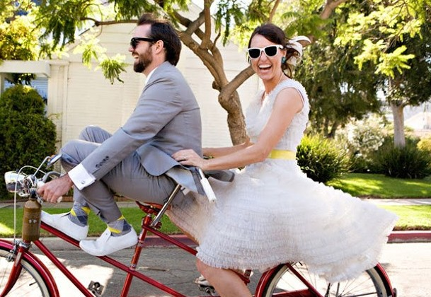 happy couple on a bike